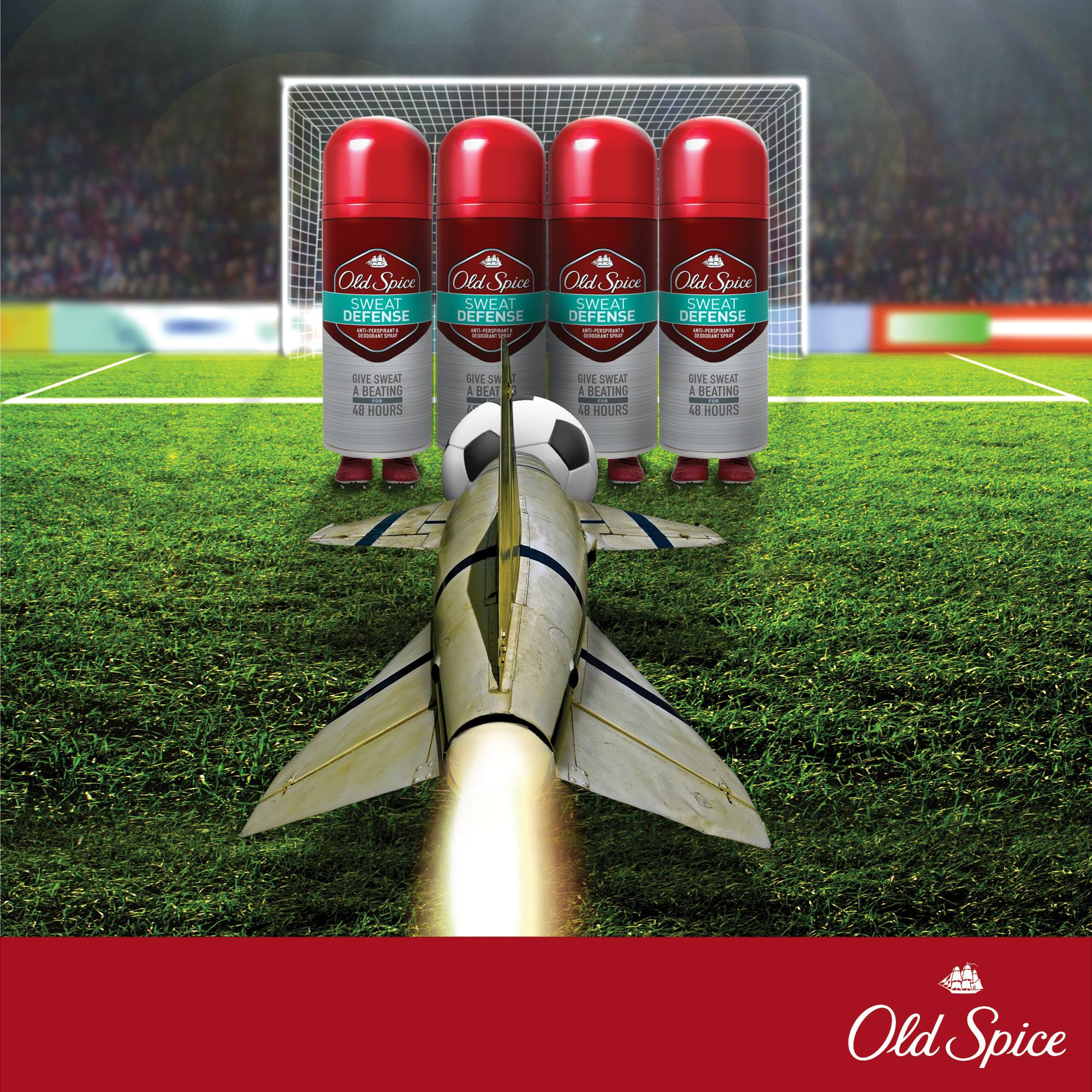 Gorilla social media marketing campaign poster of a rocket pushing a football through a wall of defense of Old Spice cans in a football pitch